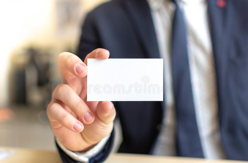 Business Card Mock-Up - Businessman Holding a Blank Card for Clients. Business Card Template. royalty free stock image