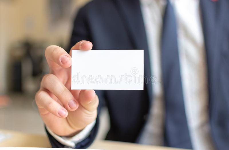 Business Card Mock-Up - Businessman Holding a Blank Card for Clients. Business Card Template. royalty free stock photography
