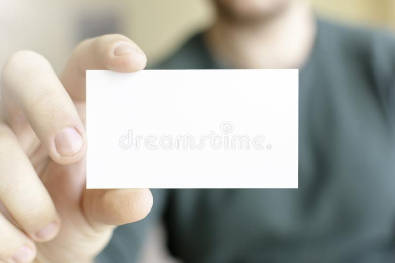 Business Card Mock-Up - Man Holding a Blank Card for Clients. Business Card Template royalty free stock photography