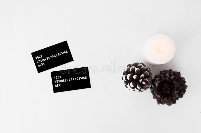 Business cards christmas composition stylish arrangement of cones download business cards christmas composition stylish arrangement of cones and candle on white background colourmoves Choice Image