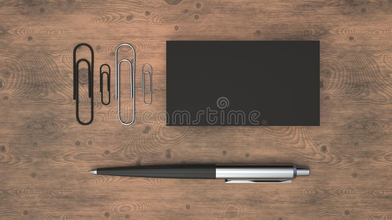 Business cards, paper clips and pen. Black business cards, paper clips and automatic ballpoint pen on wooden table. Blank paper mockup. 3D rendering illustration royalty free illustration