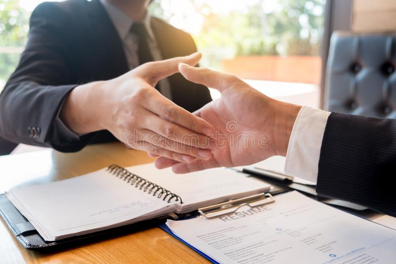 Business, career and placement concept, boss and employee handshaking after successful negotiations or interview stock images