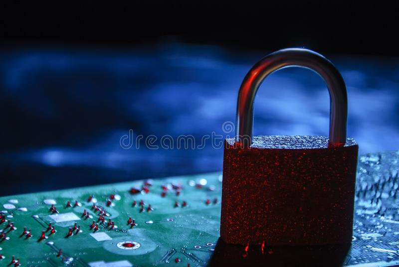 Personal data protection concept. Lock on the background of the chip stock photography