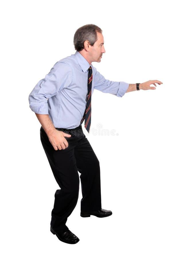 business casual caution man walking στοκ εικόνα με δικαίωμα ελεύθερης χρήσης