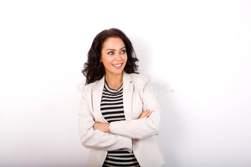Business casual woman smiling with arms crossed. Portrait of business casual woman smiling with arms crossed royalty free stock image