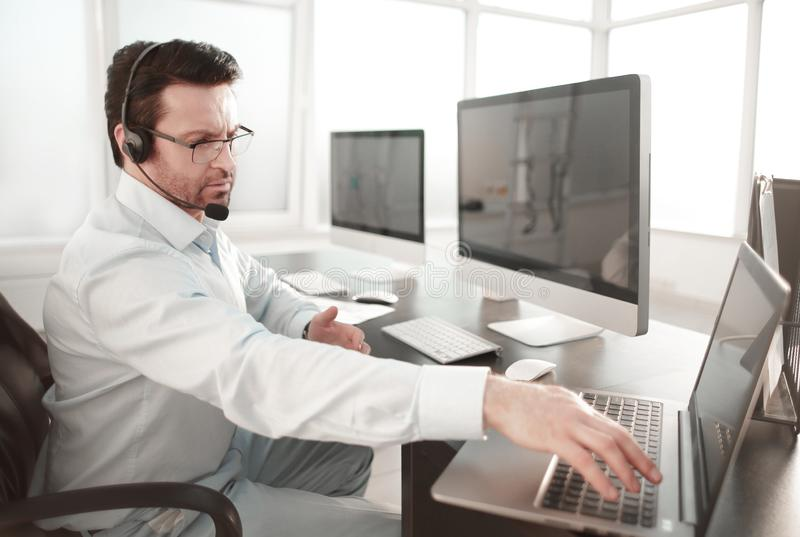 Business center employee sitting at his Desk. The concept of e-business royalty free stock photos