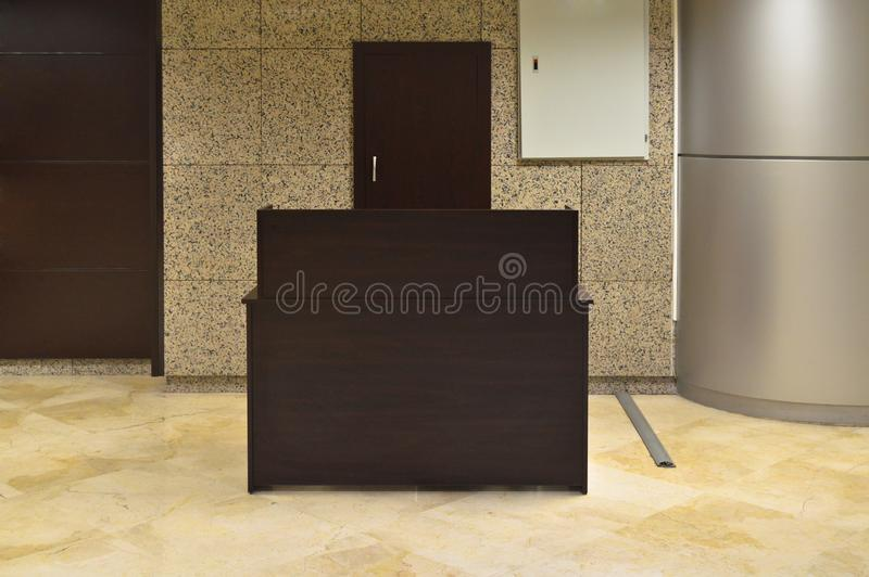 Brown reception and lobby. A business center, an empty lobby and brown reception stock photos