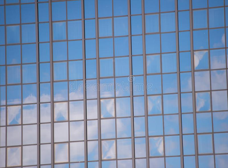 Business center. Glass facade background blue sky reflection. Modern architecture. Construction and design. Commercial. Property or real estate. Real estate stock image