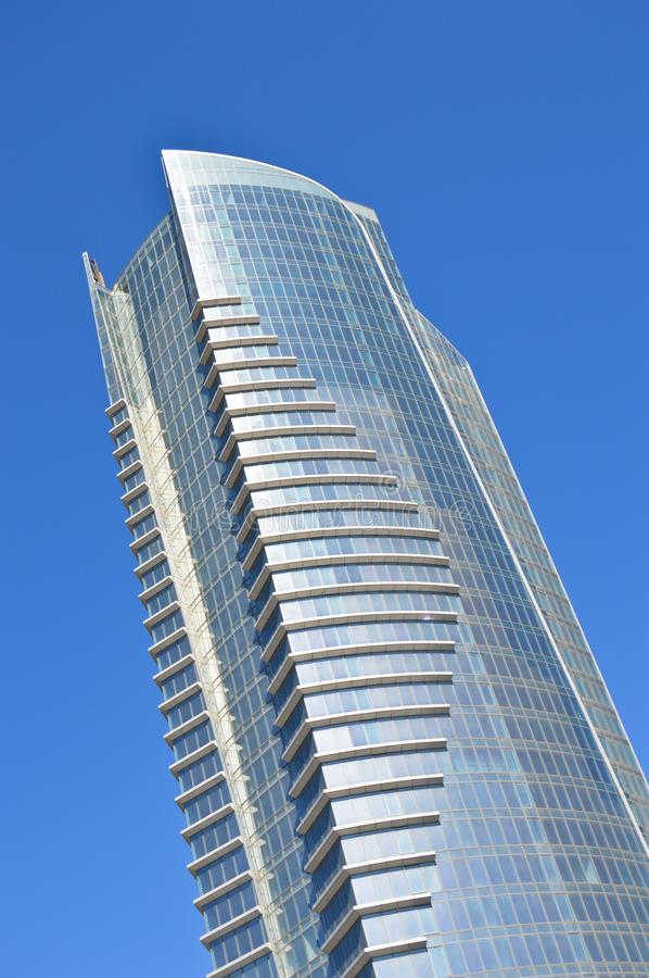 Modern glass building in the city center. Business center, institutional glass tower, Modern glass building, business center with blue sky stock photography