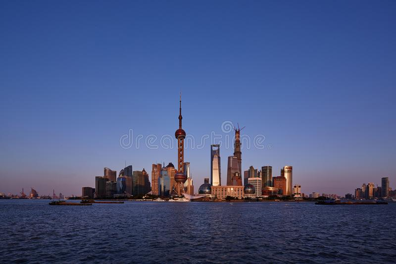Business center skyline in sunset。Under construction Shanghai Tower stock photo