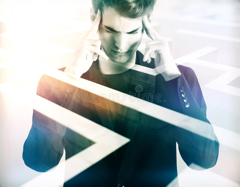 Business challenge concept. Pensive young businessman on abstract maze background. Business challenge concept. Double exposure royalty free stock images