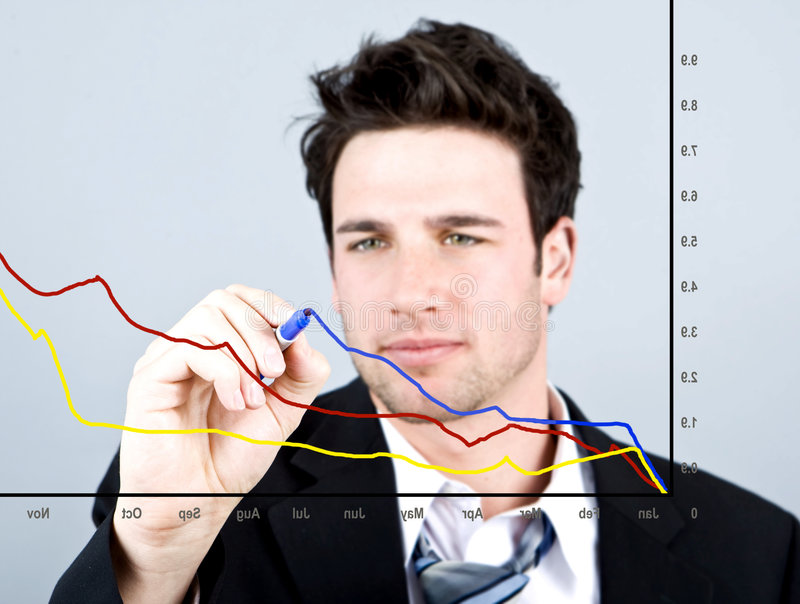 Business chart. Attractive business man drawing on a graph royalty free stock images