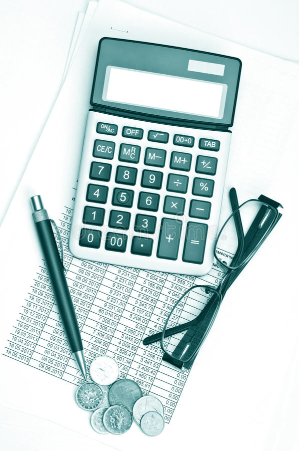Business chart. With calculator, eyglasses and coins royalty free stock photo