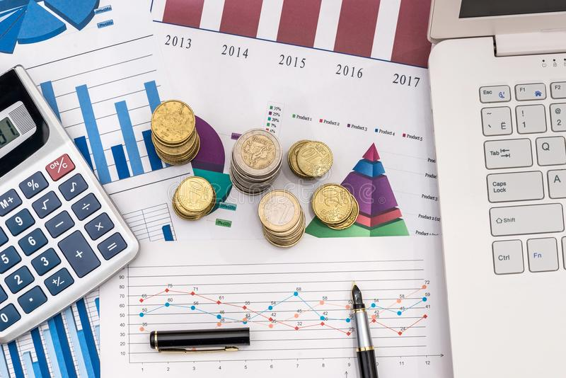 Business chart with coin and laptop. Business chart with coin and laptop royalty free stock photos