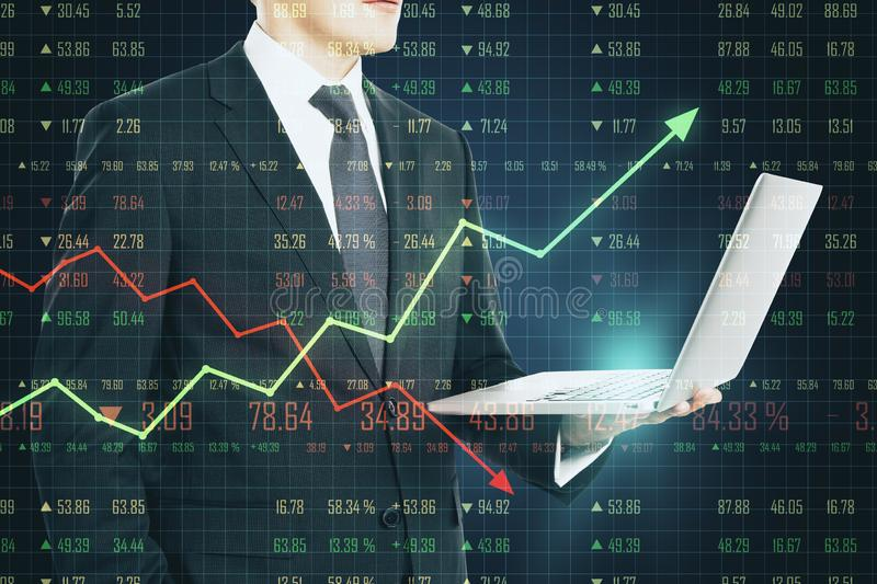 Business chart concept with businessman using laptop and trading chart screen stock images