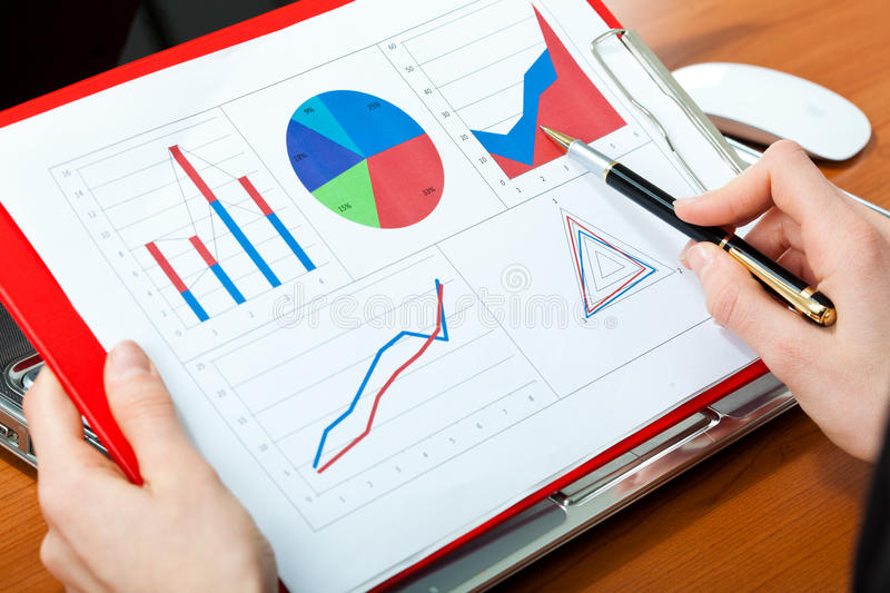 Business charts: business person accounting. Business charts: hands of a business person accounting royalty free stock photos