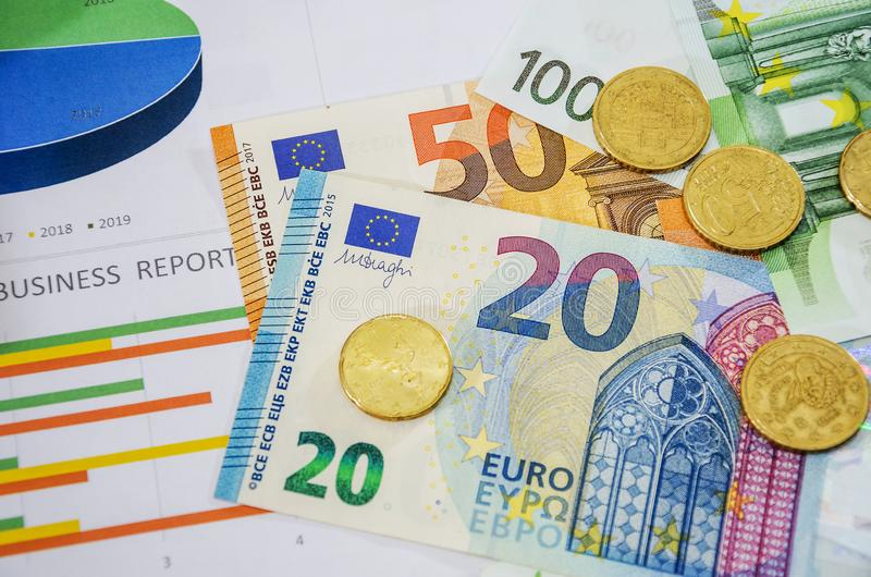 Business charts, euro and coins, close-up. View from above. Business charts, euro and coins, close-up royalty free stock photos