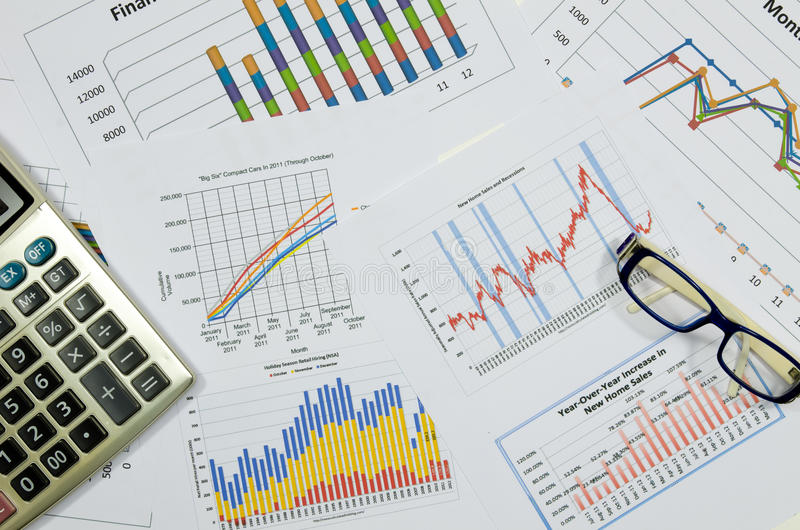 Business charts and graphs with calculator. Graphs and chart for business stock images