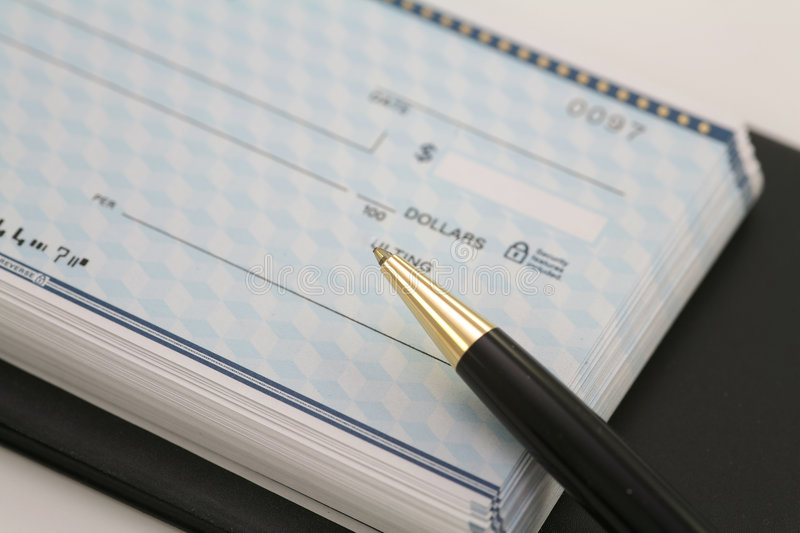 Business checks with black pen royalty free stock image