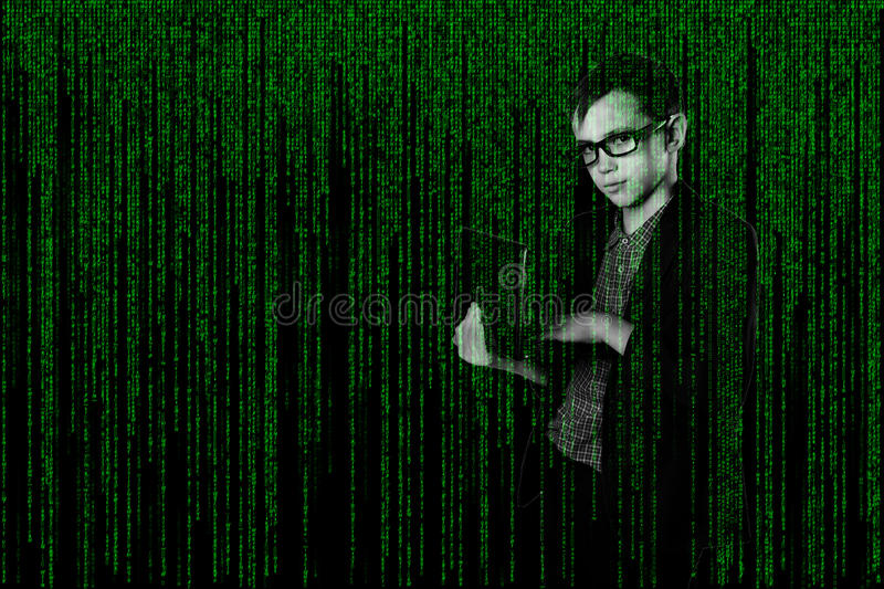 Business child with in a suit laptop in matrix style. hacker on techno-digital background stock image