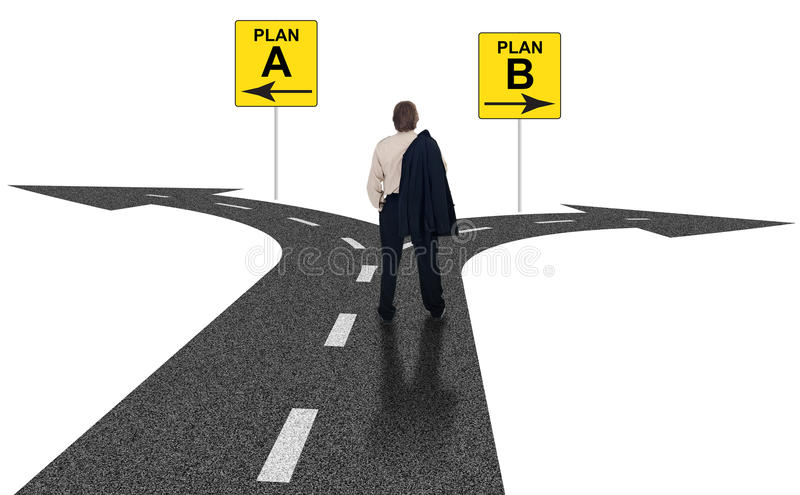 Business choices for difficult situations. Cross roads with plan A plan B road signs symbol representing business choices and challenges stock photo