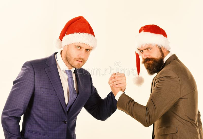 Business and Christmas vacation concept. Men in classic suits stock photos