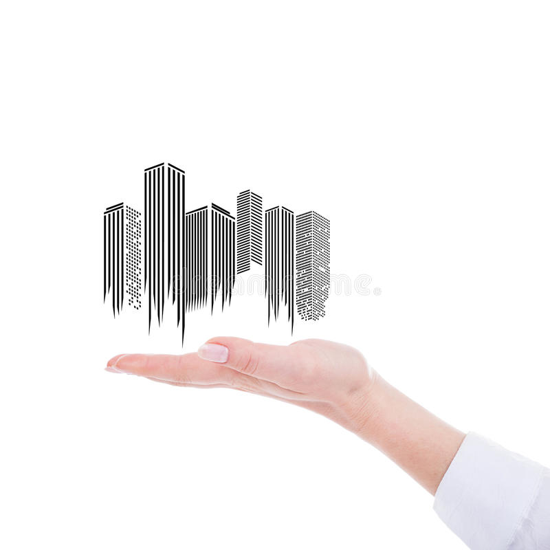 Business city center in hand. Business city center in businessman's hand on the white background royalty free stock image