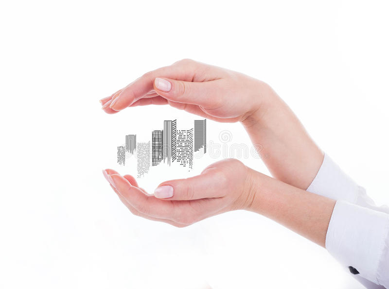 Business city center in hand. Business city center in businessman's hand on the white background royalty free stock images