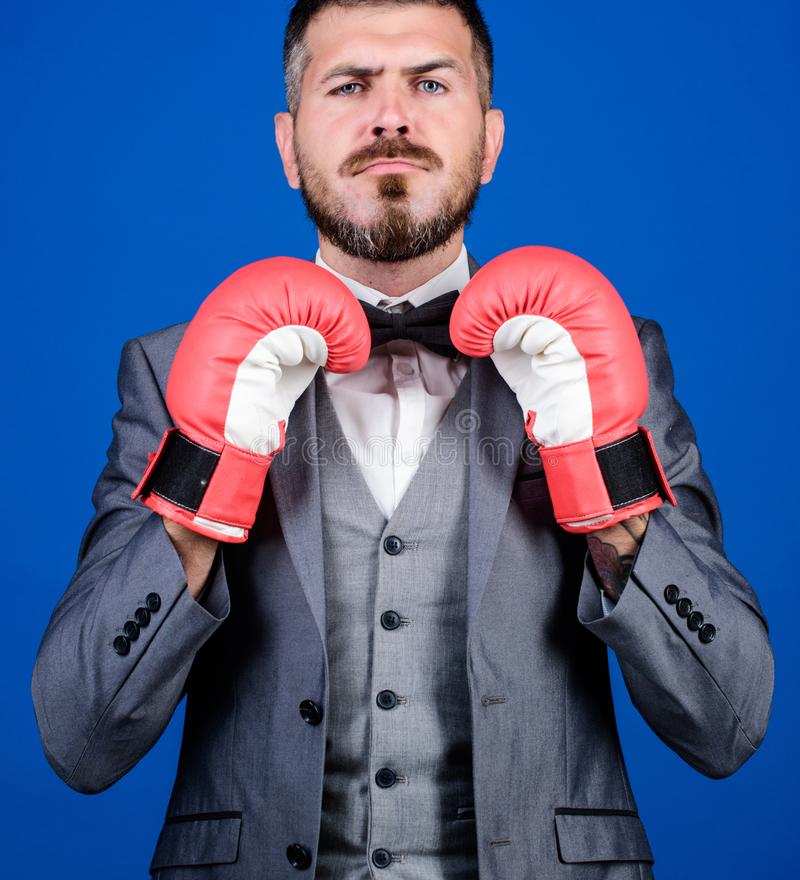 Business coach. businessman in formal suit and bow tie. bearded man in boxing gloves punching. Business and sport stock photography