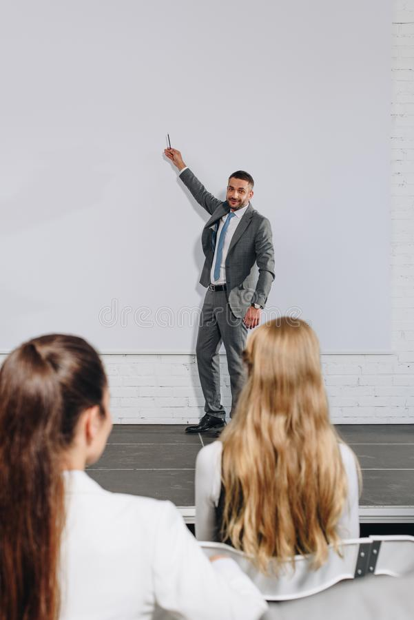 business coach pointing on board during training royalty free stock photos