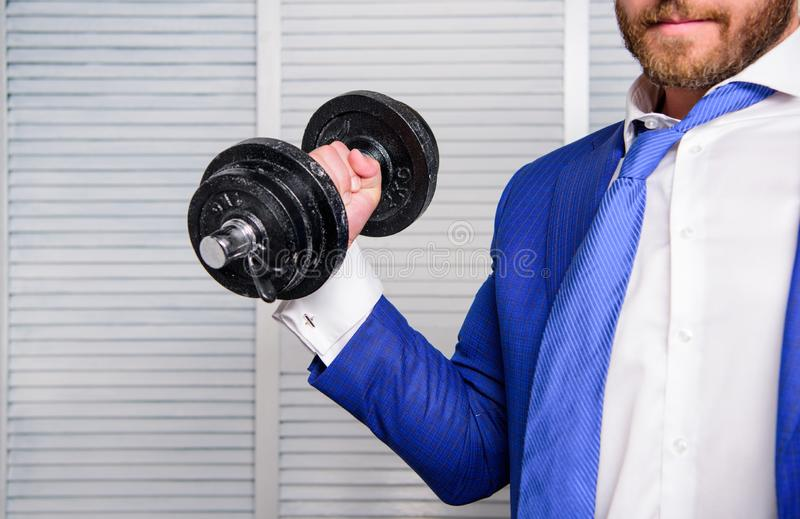 Business coach. Put more effort. Man raise heavy dumbbell. Boss businessman manager raise hand with dumbbell close up stock photo