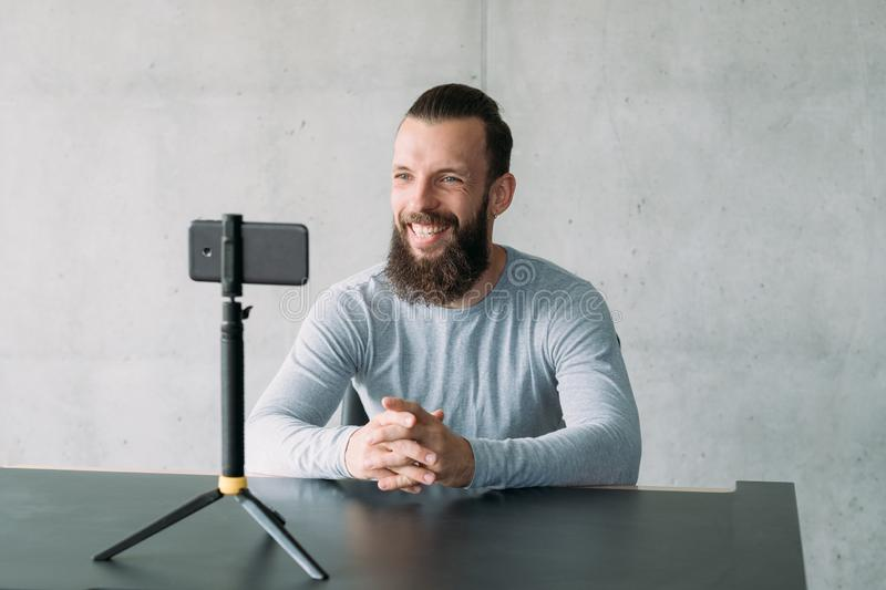 Business coaching hipster guy smartphone camera stock images
