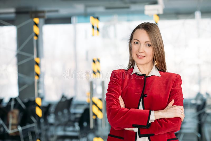 Business coaching mature female team leader. Business coaching. Mature female team leader. Successful business woman standing with arms folded at conference hall royalty free stock photography