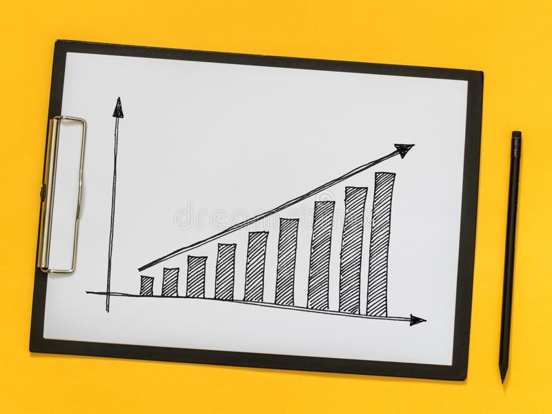 Business coaching, training. Growth chart on a piece of paper royalty free stock photos