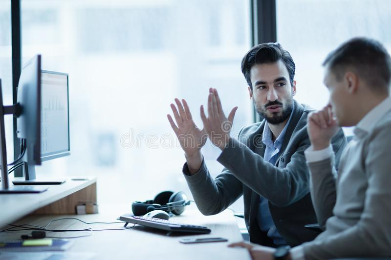 Business IT colleague explaning project details. In office royalty free stock images