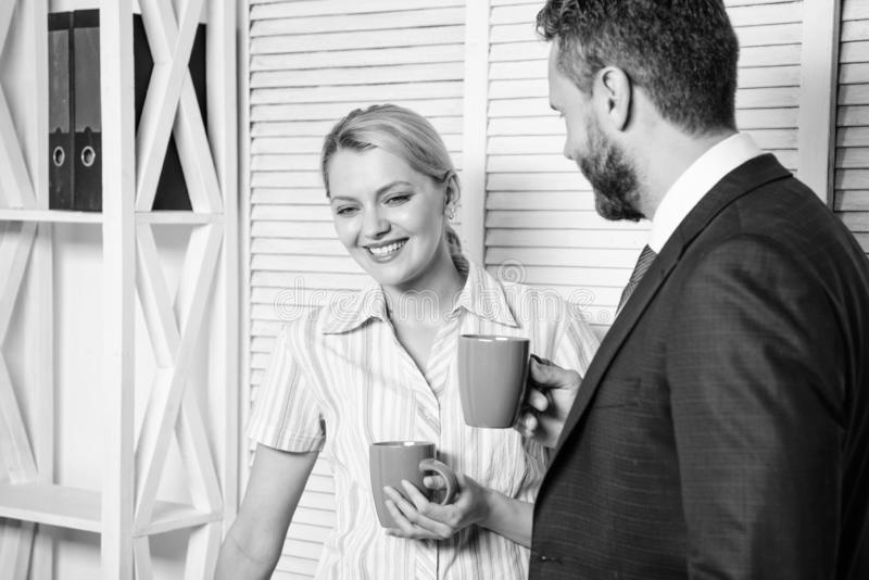 Business colleague having coffee break in the office. Two business people working together casual. Cheerful work of two. People during break time in bright royalty free stock photography