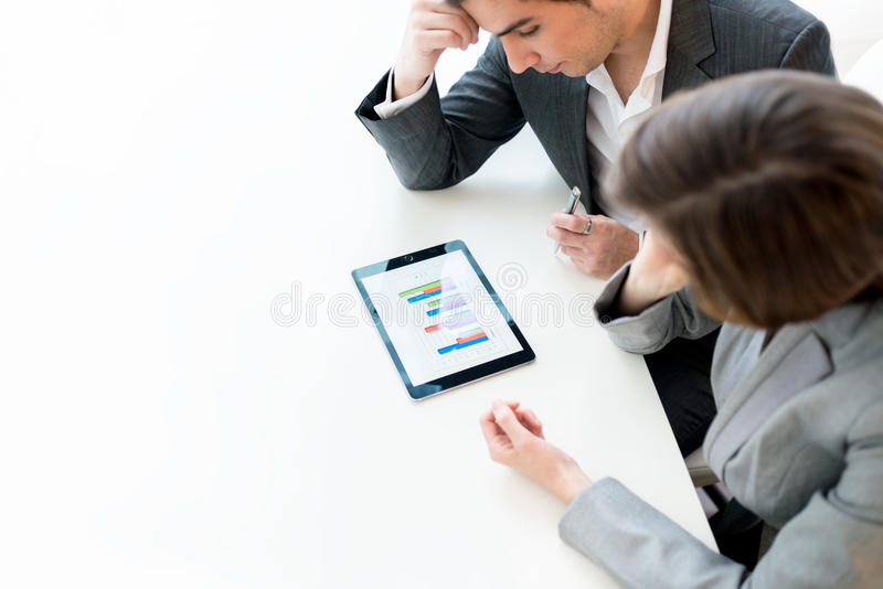 Business colleagues analysing a graph stock photos