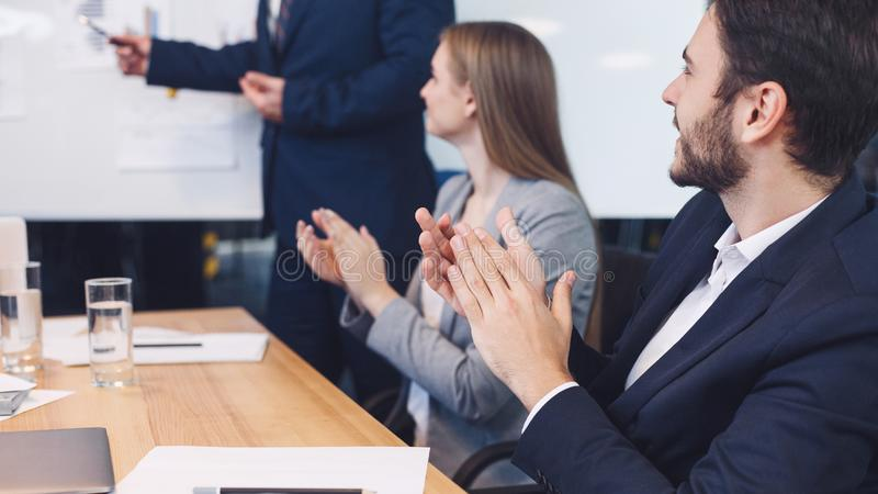 Business colleagues applauding to reporter at seminar stock photography