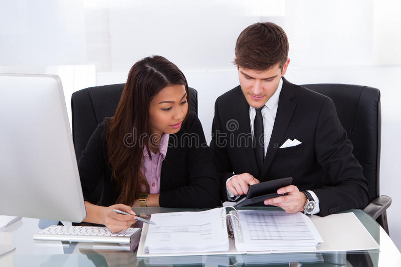 Business colleagues calculating tax stock photos