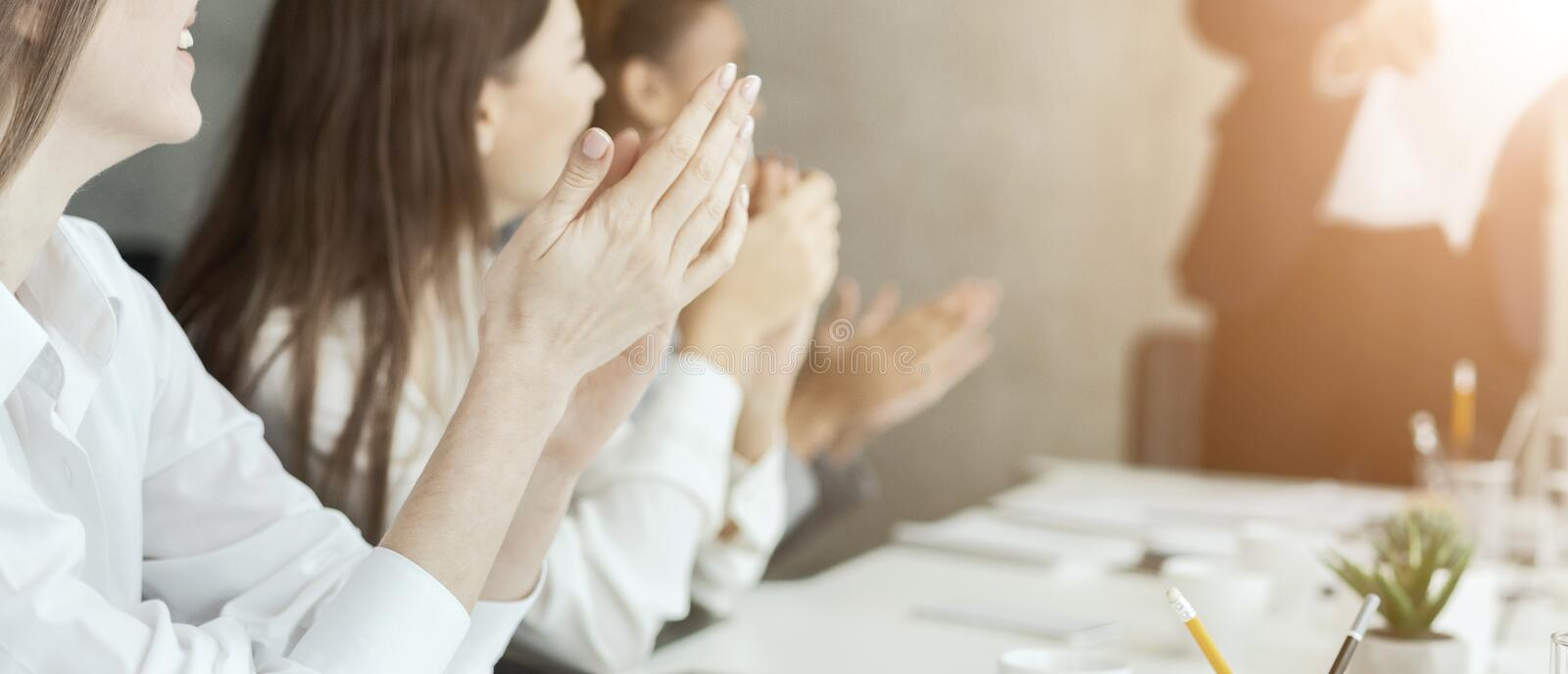 Business colleagues clapping hands at meeting, greeting speaker stock photography