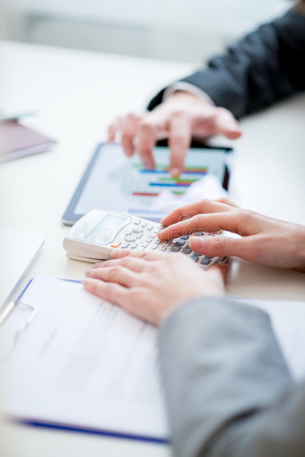 Business colleagues comparing business statistics royalty free stock photography