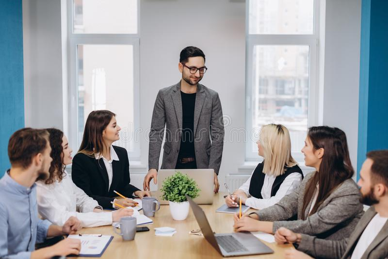 Business colleagues in conference meeting room during presentation stock image