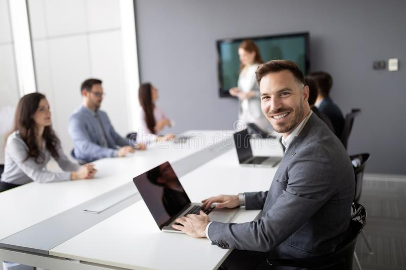 Business colleagues in conference meeting room during presentation stock photography