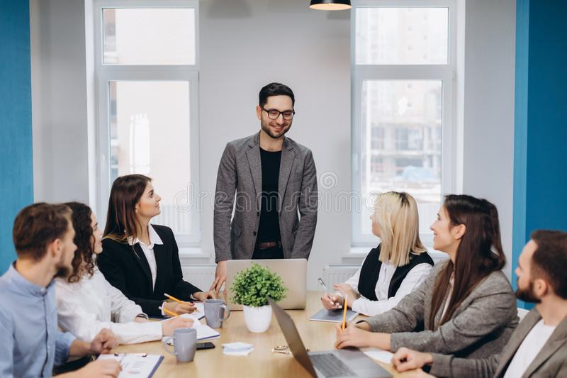 Business colleagues in conference meeting room during presentation stock photo
