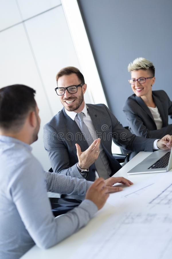 Business colleagues in conference room during meeting stock images