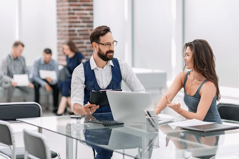 Business colleagues discuss business issues sitting at the Desk stock photo
