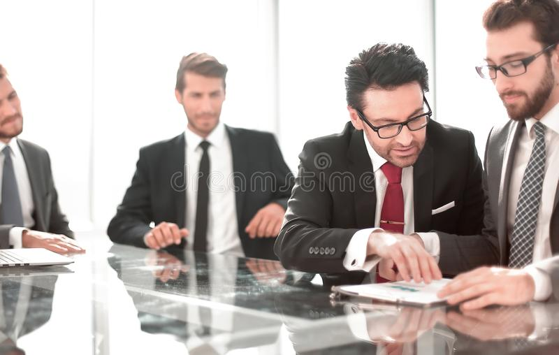 Business colleagues discussing financial documents. royalty free stock images