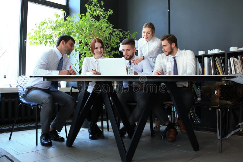 Business colleagues discussing new opportunities. people and technology royalty free stock image