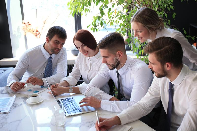 Business colleagues discussing new opportunities. people and technology stock photo