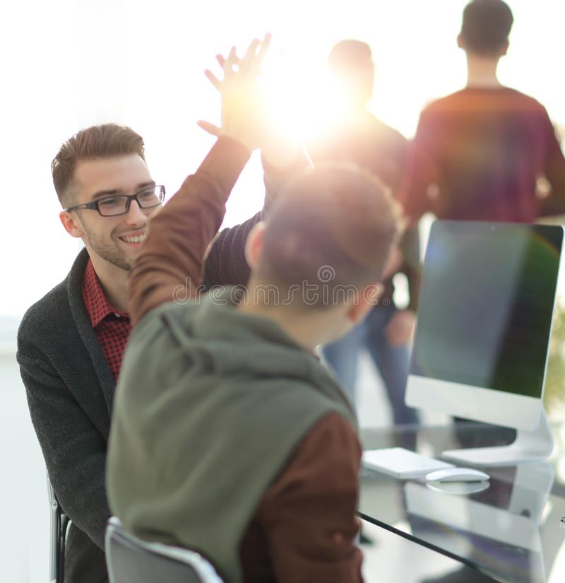 Business colleagues giving each other high five stock photo